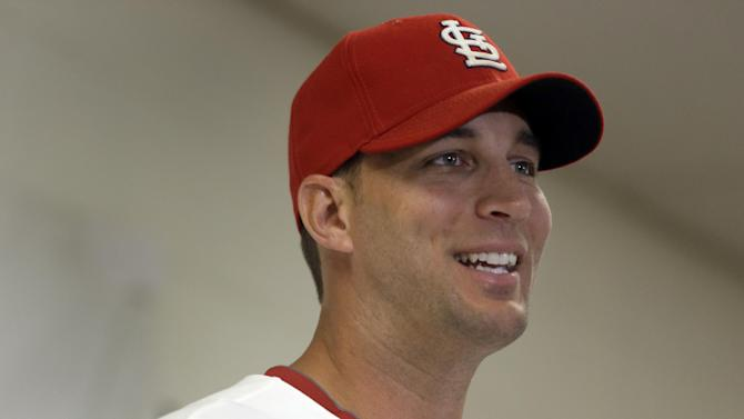 St. Louis Cardinals pitcher Adam Wainwright speaks during a news conference at the Cardinals spring training complex Thursday, March 28, 2013, in Jupiter, Fla. Wainwright and the Cardinals have agreed to a new five-year contract worth a reported $97.5 million. (AP Photo/Jeff Roberson)