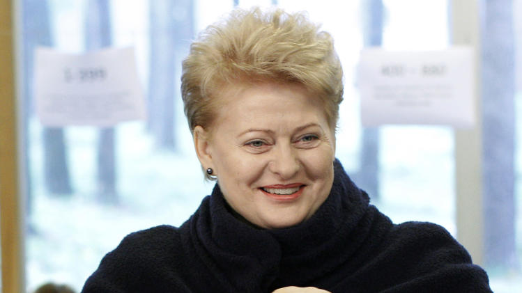 Lithuania's President Dalia Grybauskaite casts her ballot at a polling station in Vilnius, Lithuania, Sunday, Oct. 14, 2012. Lithuanians are expected to deal a double-blow to the incumbent conservative government in national elections Sunday by handing a victory to opposition leftists and populists and saying 'no' to a new nuclear power plant that supporters claim would boost the country's energy independence. (AP Photo/Mindaugas Kulbis)