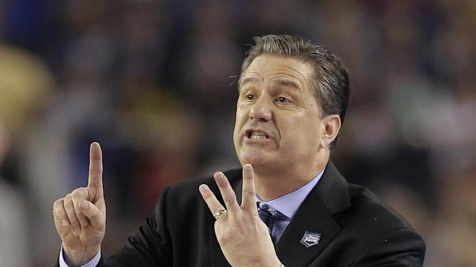 Kentucky head coach John Calipari directs his team during the first half of the NCAA Final Four tournament college basketball championship game against Connecticut Monday, April 7, 2014, in Arlington, Texas