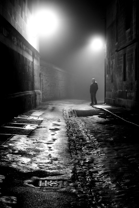 Man in the Fog by Stephen Colbrook, Oxford, England (Overall Young Photographer of the Year Winner): Stephen said his photo helped draw the viewer in throughn the 'diagonal lines of the buildings, com