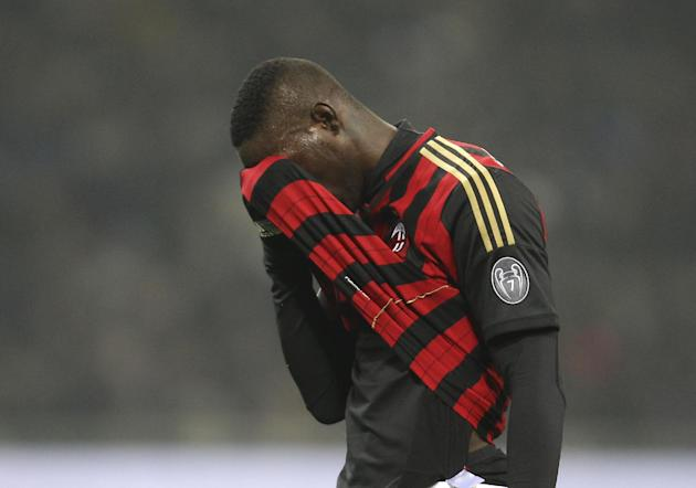 AC Milan forward Mario Balotelli reacts after missing a scoring chance during the Serie A soccer match between Inter Milan and AC Milan at the San Siro stadium in Milan, Italy, Sunday, Dec. 22, 2013.