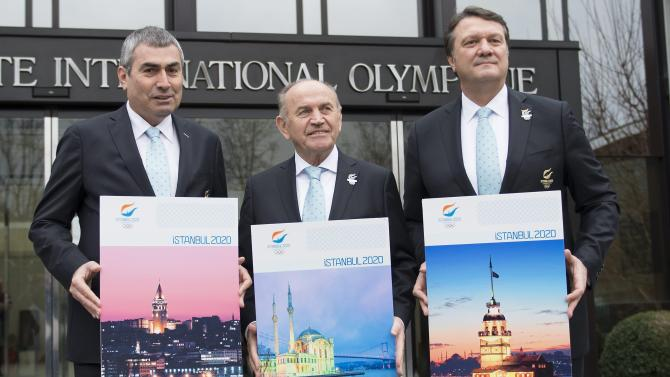 From left, Ugur Erdener, International Olympic Committee member, the President of the Turkish National Olympic Committee and the President of World Archery, Kadir Topbas, the Mayor of Istanbul, Hasan Arat, Istanbul 2020 Bid Chairman and the Vice President of the Turkish National Olympic Committee, pose for photographers in front of the IOC headquarters before they submit their candidature bid of 2020 Istanbul Olympic summer games at the International Olympic Committee, IOC, headquarters in Lausanne, Switzerland, Monday, Jan. 7, 2013. The International Olympic Committee announced that Istanbul, Tokyo and Madrid have made it on to the short list of cities bidding to host the 2020 Olympic Games. (AP Photo/Keystone, Jean-Christophe Bott)