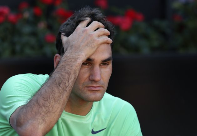Roger Federer of Switzerland reacts after losing the men's singles final match to Rafael Nadal of Spain at the Rome Masters tennis tournament