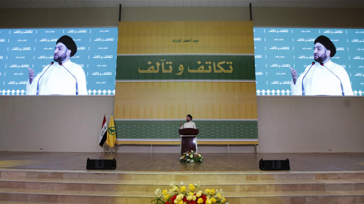 Ammar al-Hakim, leader of the Islamic Supreme Council of Iraq (ISCI), gives a speech during prayers for the Muslim festival of Eid al-Fitr in Baghdad