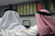 "Traders follow the market's movement at the Bahraini Stock Exchange in Manama. Bahrain has successfully issued a $1.5 billion conventional bond that was four times over subscribed, demonstrating ""confidence"" in the kingdom's financial sector"