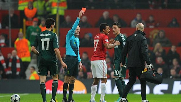 Manchester United's Nani, second from right, was shown a red card by referee Cuneyt Cakir