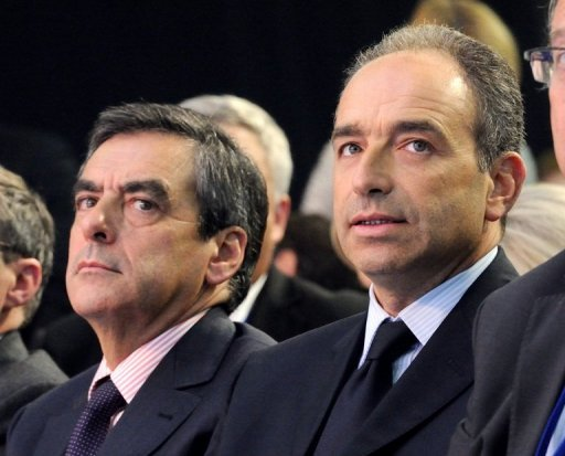<p>Francois Fillon (L), and his opponent Jean-Francois Cope are pictured on September 27, 2012. The rivals in a bitter leadership row that split France's former ruling party, the rightwing UMP of Nicolas Sarkozy, agreed Monday to a new internal election after a contested first vote last month.</p>