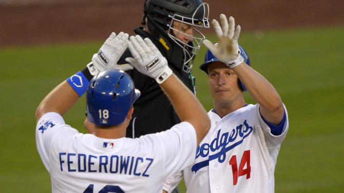 Los Angeles Dodgers' Mark Ellis, right, is congratulated by Tim Federowicz after hitting a two-run home run during the third inning of the Dodgers' baseball game against the San Francisco Giants, Tuesday, June 25, 2013, in Los Angeles. (AP Photo/Mark J. Terrill)