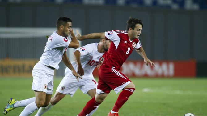 Gibraltar's Chipolina and Walker chase Georgia's Kazaishvili during their Euro 2016 qualifying soccer match in Tbilisi