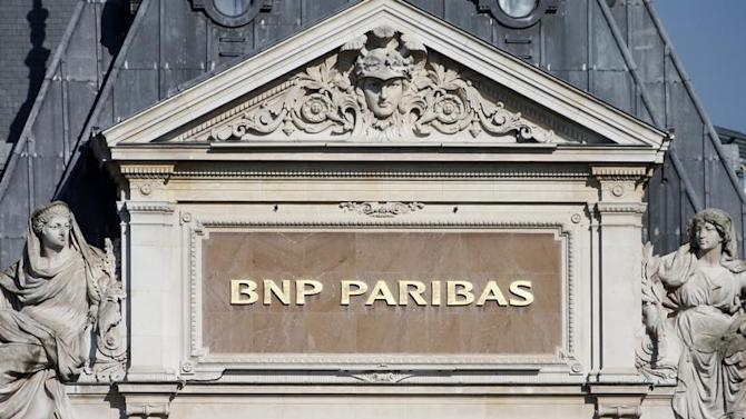 The BNP Paribas plaque is seen on the roof of one of their main banks in central Paris