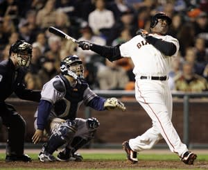 FILE - In this Aug. 24, 2007, file photo, San Francisco Giants' Barry Bonds, right, hits his 761st career home run, a solo effort, off Milwaukee Brewers pitcher Chris Capuano in the fourth inning of a baseball game in San Francisco. Bonds, Roger Clemens and Sammy Sosa are set to show up on the Hall of Fame ballot for the first time on Wednesday, Nov. 28, 2012, and fans will soon find out whether drug allegations block the former stars from reaching baseball's shrine. (AP Photo/Marcio Jose Sanchez, File)