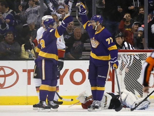 Los Angeles Kings Jeff Carter celebrates with Dustin Brown after scoring on Calgary Flames goaltender Miikka Kiprusoff during their NHL hockey game in Los Angeles