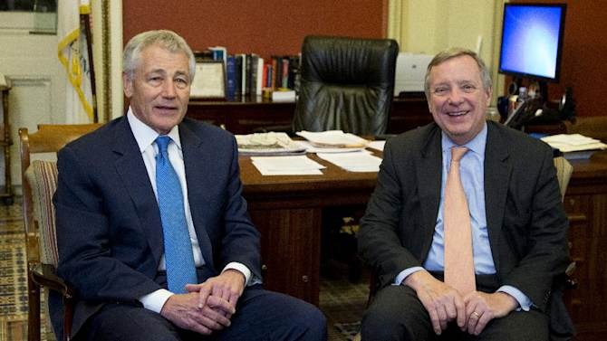 Sen. Dick Durbin, D-Ill., right, and Secretary of Defense-nominee and former Sen. Chuck Hagel, R-Neb., left, listen to reporters' question following their meeting on Capitol Hill in Washington, Tuesday, Jan. 22, 2013.   (AP Photo/Manuel Balce Ceneta)