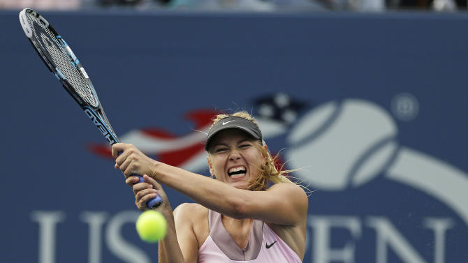 Maria Sharapova, of Russia, returns a shot to Melinda Czink, of Hungary, at the 2012 US Open Tennis tournament, Monday, Aug. 27, 2012, in New York. (AP Photo/Mike Groll)