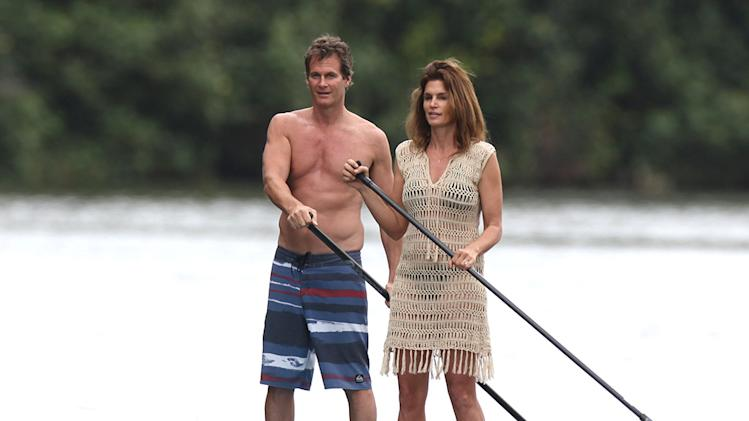 Cindy Crawford goes stand up paddle boarding on a river while vacationing in Hawaii