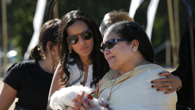 Indian Sitar maestro Ravi Shankar's wife Sukanya Rajan, right, is comforted by daughter Anoushka Shankar as they leave after a memorial service for Shankar in Encinitas, Calif., Thursday, Dec. 20, 2012. Shankar was a master of the Indian sitar who collaborated with and influenced George Harrison, John Coltrane and other Western music icons. He lived in Encinitas for two decades and died last week at age 92. (AP Photo/Jae C. Hong)