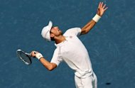 Novak Djokovic of Serbia serves to Andreas Seppi of Italy at the ATP-WTA Cincinnati Masters. Djokovic won his opening match 7-6 (7/4), 6-2 over Seppi