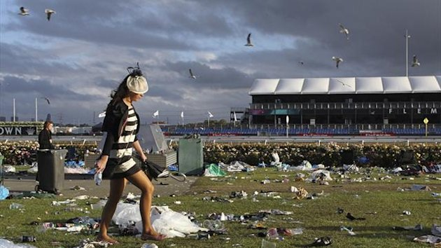 A spectator leaves the field after the Melbourne Cup at Flemington racecourse in 2011 (Reuters)