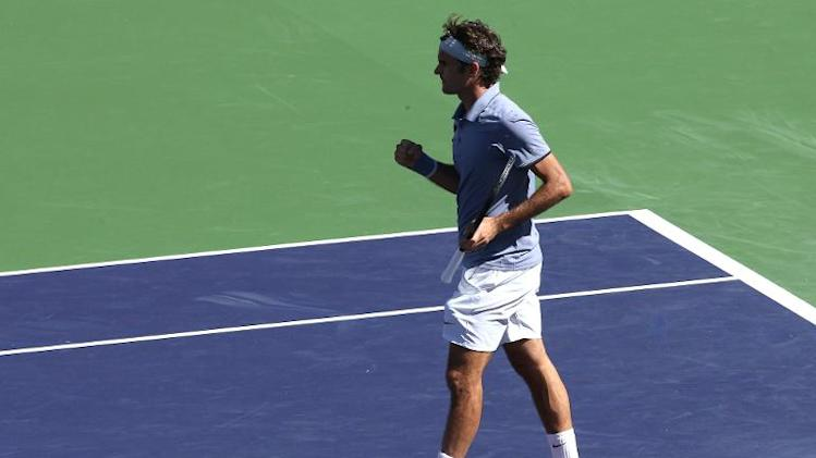 Roger Federer of Switzerland celebrates after winning match point against Dmitry Tursunov of Russia during the BNP Paribas Open, at Indian Wells Tennis Garden in California, on March 9, 2014