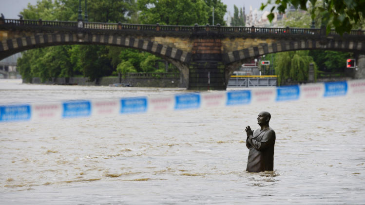 A flooded statue stands in the swollen Vltava river in the center of Prague, Czech Republic, Sunday, June 2, 2013. Heavy rainfalls cause flooding along rivers and lakes in Germany, Austria, Switzerland and the Czech Republic. (AP Photo/CTK, Roman Vondrous) SLOVAKIA OUT