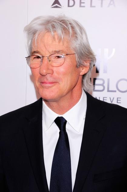 Richard Gere steps out in a classy suit at the amfAR New York Gala to kick off Fall 2011 Fashion Week in New York City on February 9, 2011  -- Getty Images