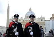 Carabinieri policemen stand in front of St Peter's basilica at the Vatican in Rome on February 12, 2012. The Vatican prepared for a momentous transition after Pope Benedict XVI announced he will resign on February 28, starting with a special mass on Wednesday and culminating in a final farewell in St Peter's Square on the eve of his departure