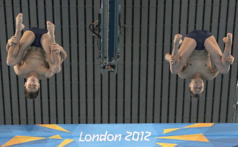 SIlver medalists German Sanchez Sanchez, right, and Ivan Garcia Navarro of Mexico compete during the Men's Synchronized 10 Meter Platform Diving final at the Aquatics Centre in the Olympic Park during the 2012 Summer Olympics in London, Monday, July 30, 2012. (AP Photo/Christophe Ena)