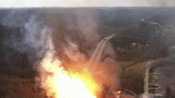 This image provided by the West Virginia State Police shows a fireball erupting across Interstate 77 from a gas line explosion in Sissonville, W. Va.,Tuesday Dec. 11, 2012. At least five homes went up in flames Tuesday afternoon and a badly damaged section of Interstate 77 was shut down in both directions near Sissonville after a natural gas explosion triggered an hour-long inferno that officials say spanned about a quarter-mile.  (AP Photo/West Virginia State Police)