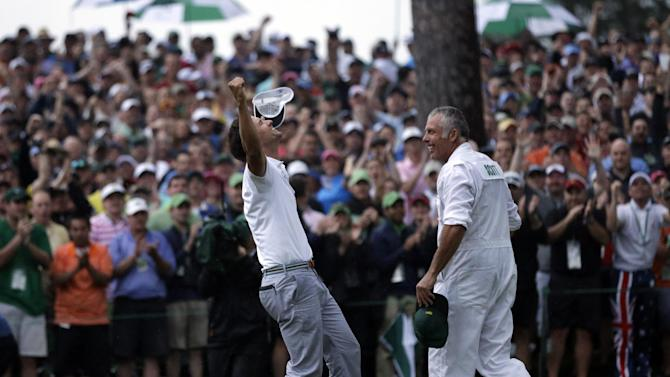 Adam Scott, of Australia, celebrates with caddie Steve Williams after making a birdie putt on the second playoff hole to win the Masters golf tournament Sunday, April 14, 2013, in Augusta, Ga. (AP Photo/David J. Phillip)