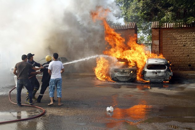 Cars burn after riots broke out in front of a luxury hotel in central Cairo., Egypt, Thursday, Aug. 2, 2012. A security official said one person was killed when Egyptian police opened fire on a mob trying to storm a Nile-side luxury hotel in central Cairo. The official said the crowd of around 500 people smashed the hotel's lobby and set ablaze 10 cars and dozens of motorcycles outside the building, located in a skyscraper housing a glitzy shopping mall and offices. (AP Photo)