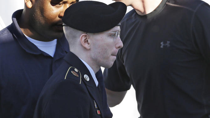 Army Pfc. Bradley Manning is escorted into a courthouse at Fort Meade, Md., Tuesday, June 4, 2013, before the second day of his court martial. Manning is charged with indirectly aiding the enemy by sending troves of classified material to WikiLeaks. He faces up to life in prison. (AP Photo/Patrick Semansky)