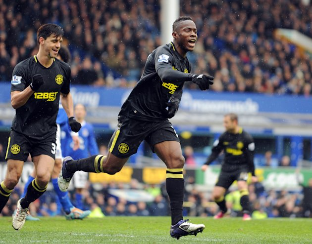Wigan Athletic's Maynor Figueroa, right, celebrates after he scores the first goal of the game for his side during their English FA Cup sixth round soccer match at Goodison Park in Liverpool, England,
