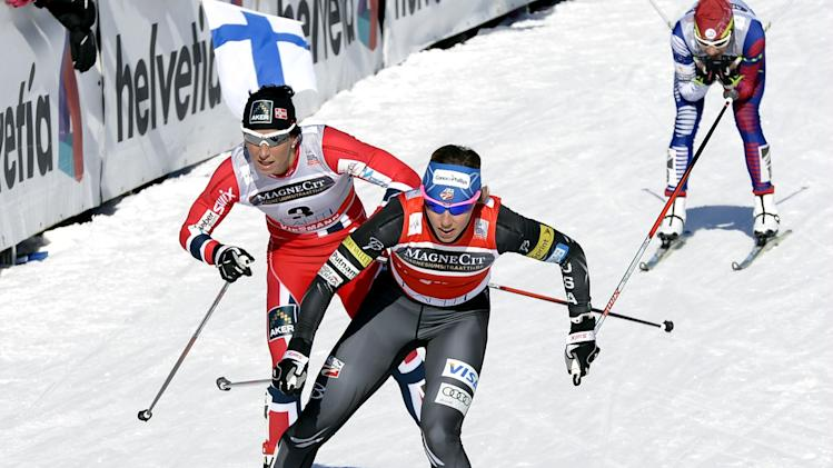 U.S. Kikkan Randall, left, leads Norway's Marit Bjorgen in the ladies World Cup sprint event at the Lahti Ski Games on Saturday, March 9, 2013. (AP Photo Lehtikuva, Heikki Saukkomaa) FINLAND OUT - NO SALES