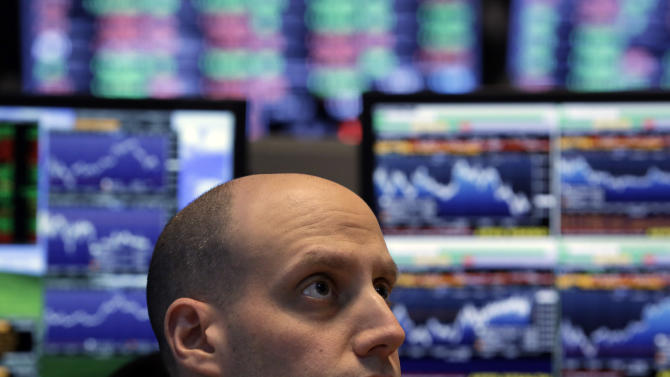Dow edges near record, then sputters; stocks down
