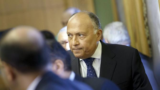 Egyptian Foreign Minister Sameh Shukri and others arrive for the opening of a U.S.-Egypt strategic dialogue at the Ministry of Foreign Affairs in Cairo