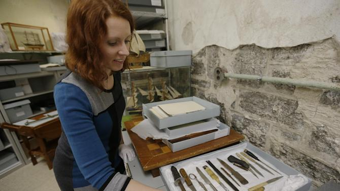 """In this Tuesday, March 12, 2013 photo, Erica Harman, during an interview with the Associated Press,  shows examples of shanks made by inmates at the Eastern State Penitentiary in Philadelphia. The defunct and decayed prison that serves as one of Philadelphia's quirkiest tourist attractions, plans to displaying dozens of never-before-seen artifacts for 10 days only in a """"pop-up museum."""" (AP Photo/Matt Rourke)"""