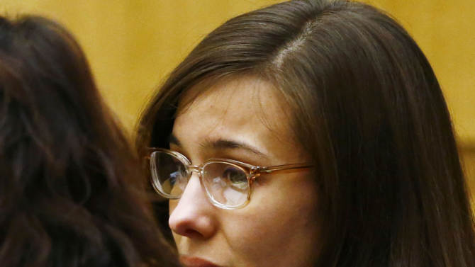 """FILE - In this May 8, 2013 file photo, Jodi Arias reacts at Maricopa County Superior Court in Phoenix after she was found of guilty of first-degree murder in the gruesome killing of her one-time boyfriend, Travis Alexander, in their suburban Phoenix home. Arias returns to an Arizona courtroom Wednesday, May 15, 2013 for the """"aggravation"""" phase of her trial, during which jurors will determine whether the death penalty should be an option for sentencing her. (AP Photo/The Arizona Republic, Rob Schumacher, Pool, File)"""