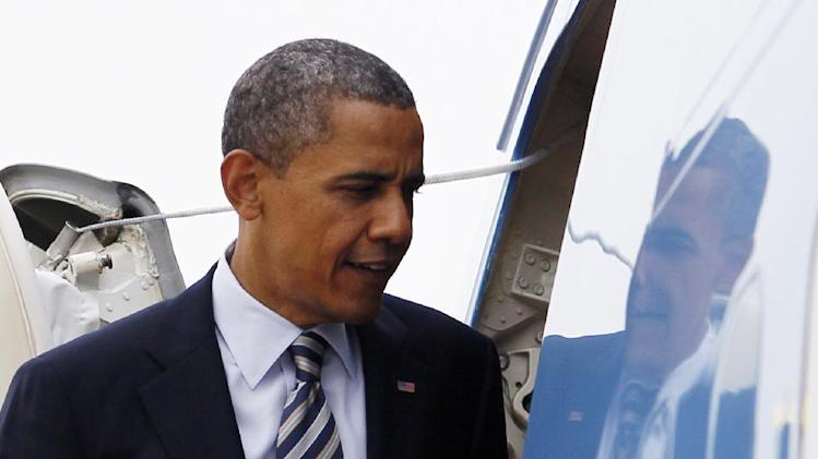President Barack Obama boards Air Force One, Friday, June 1, 2012, at Andrews Air Force Base, Md., en route to Minneapolis. (AP Photo/Carolyn Kaster)