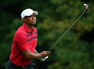 Tiger Woods of the US Team watches his approach shot on the 15th hole during the day three four-ball matches at the Muirfield Village Golf Club in Dublin, Ohio on October 5, 2013