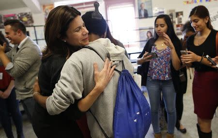 Opera singer Ana Maria Martinez hugs a student during a visit at Lake View High School in Chicago