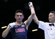 Jose Ramirez of the USA is awarded a 21-20 points victory over Rachid Azzedine of France during the London 2012 Olymipic Games on July 29. The United States men&#39;s boxing team was cleared on Wednesday by amateur boxing chiefs of allegations their fighters had signed contracts with professional promoters prior to the Olympic Games