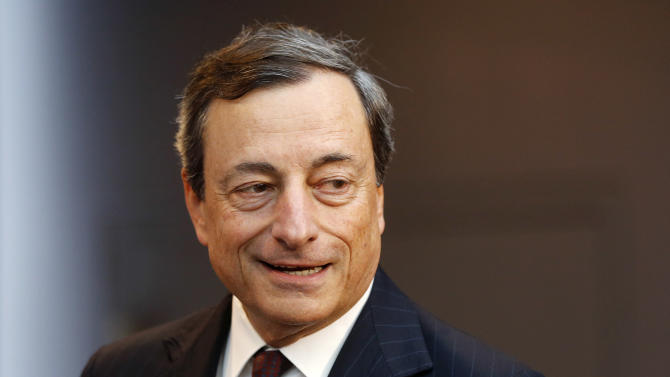 President of European Central Bank Mario Draghi is on his way to a news conference in Frankfurt, Germany, Thursday, July 4, 2013, following a meeting of the ECB governing council. The ECB decided to leave the key interest rate unchanged. (AP Photo/Michael Probst)