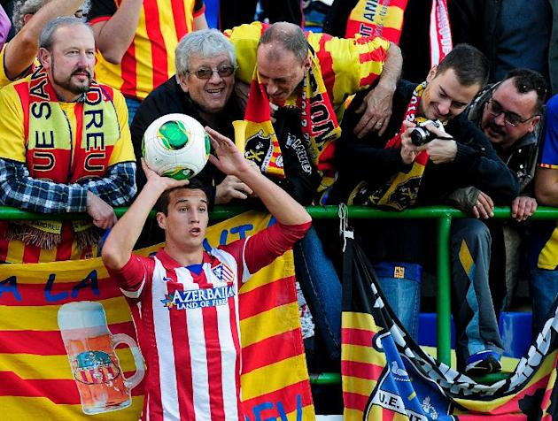 Sant Andreu's football fans tease Atletico Madrid's defender Javier Manquillo Gaitan as he executes a throw-in during the Spanish Copa del Rey (King's Cup) finals stage match at the Munici