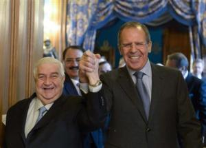 Moualem and Lavrov enter a hall before the talks in…