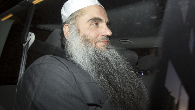 Abu Qatada is driven away after being refused bail at a hearing at London's Special Immigration Appeals Commission, which handles deportation and security cases, in London, Tuesday, April 17, 2012.  New pledges from Jordan to offer a fair trial to the radical Islamist cleric should end Britain's lengthy campaign to send the preacher to the Arab country, Home Secretary Theresa May told lawmakers Tuesday. Since 2001, authorities in Britain have been trying to expel Abu Qatada, a Palestinian-Jordanian preacher described in both Spanish and British courts as a leading al-Qaida figure in Europe.  (AP Photo/Alastair Grant)