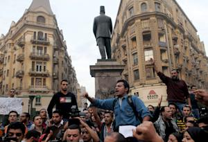 Protesters chant slogans in Talaat Harb Square …