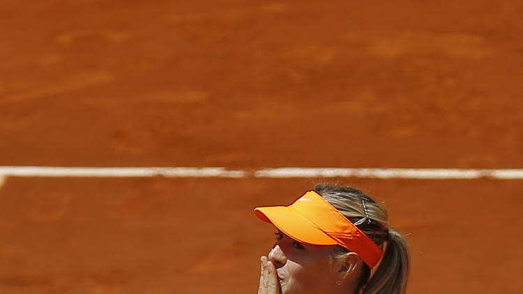 Maria Sharapova from Russia reacy=ts after winning her match against  Kaia Kanepi from Estonia during the Madrid Open tennis tournament, in Madrid,  Friday, May 10, 2013. (AP Photo/Daniel Ochoa de Olza)