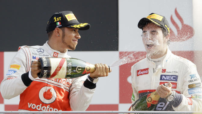 FILE - In this Sunday, Sept. 9, 2012 file photo McLaren Mercedes driver Lewis Hamilton, left, of Britain, celebrates on the podium with second placed Sauber driver Sergio Perez, of Mexico, after winning the Italian Formula One GP, at the Monza racetrack, in Monza, Italy. Formula One team McLaren has signed Mexican driver Sergio Perez for next season, part of a shakeup that is expected to see Lewis Hamilton move to Mercedes. Hamilton's switch to Mercedes is expected to be announced later Friday Sept. 28, 2012. He would replace seven-time world champion Michael Schumacher, who has also been linked to a move to Sauber to replace Perez. (AP Photo/Antonio Calanni, File)