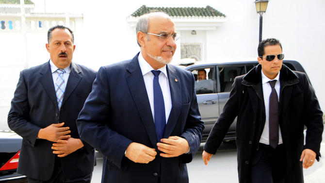 Tunisian Prime Minister Hamadi Jebali, center, arrives for meeting with political parties in an effort to end a crisis exacerbated by a political assassination two weeks ago, outside Tunis, Monday, Feb. 18, 2013. Jebali's initiative, while supported by the opposition, puts him on a collision course with the moderate Islamist Ennahda Party, which dominates the government and insists on sticking with a cabinet of political figures. (AP Photo/Hassene Dridi)