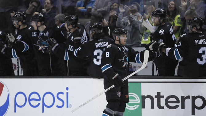 San Jose Sharks center Joe Pavelski (8) is high-fived by teammates after scoring a goal against the Edmonton Oilers during the second period of an NHL hockey game in San Jose, Calif., Thursday, Jan. 31, 2013. (AP Photo/Tony Avelar)
